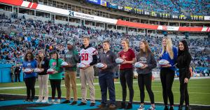 High school captains during their pre-game awards ceremony at Bank Of America Stadium in Charlotte, NC.